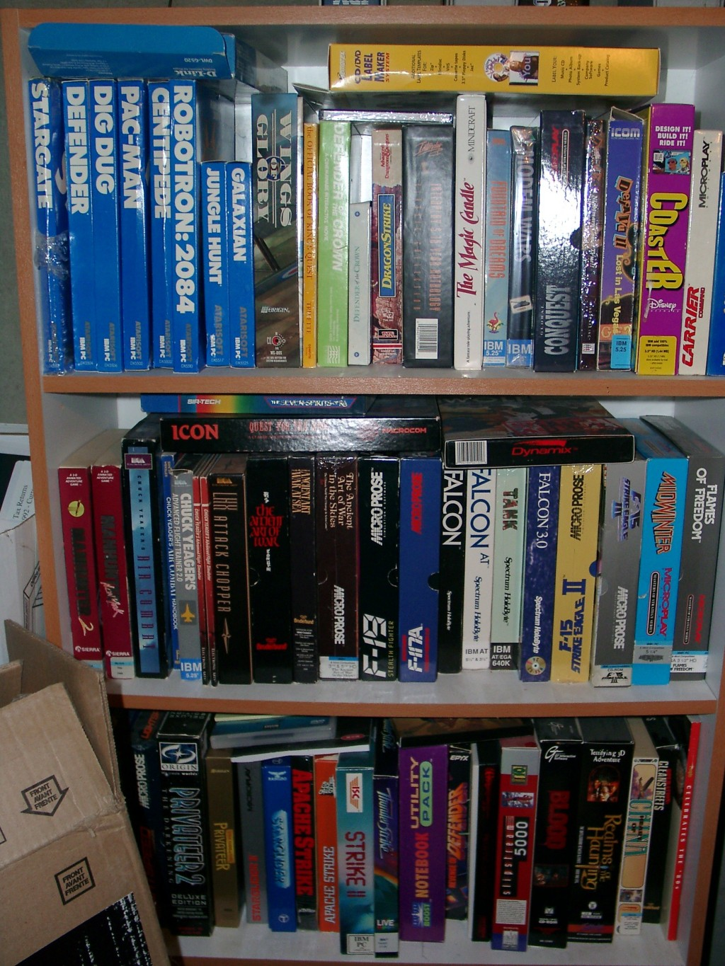 bookshelf filled with computer games